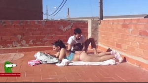 Horny teen is sucking and riding a big, black cock, while on the rooftop of a building