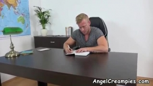 Red haired woman, Jill Kassidy is fucking her boss in her office, chained to a desk