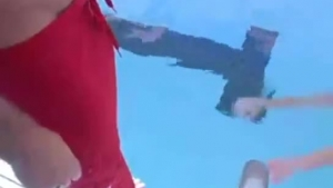 Tattooed guy is fucking an older girl next to the swimming pool, and eating her pussy