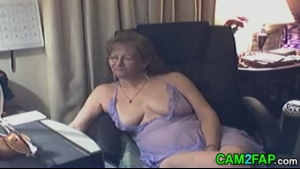 Lovely granny teasing against a screen
